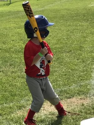 Player in red shirt ready to swing