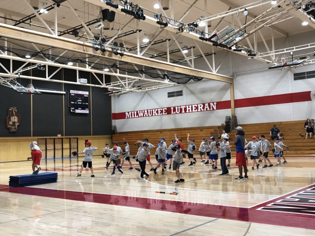 Group of players doing the circuit in the Milwaukee Lutheran High school gym