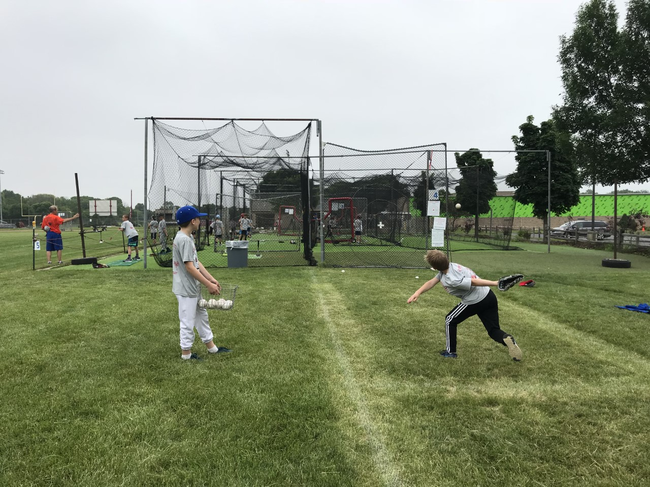 Player practicing pitching at a net